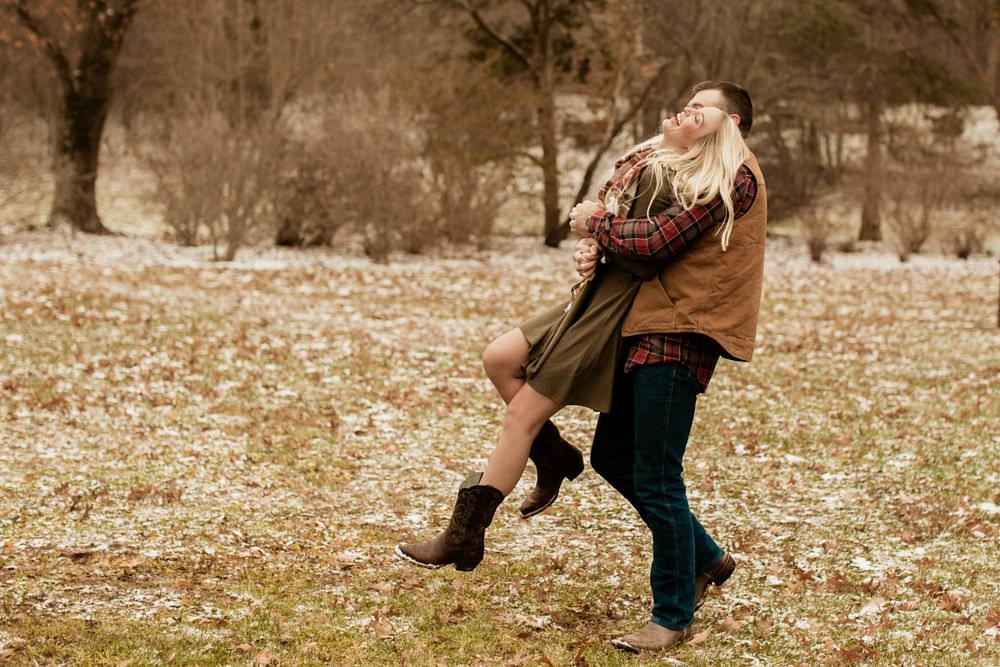 Man picking up woman at carefree & fun engagement session