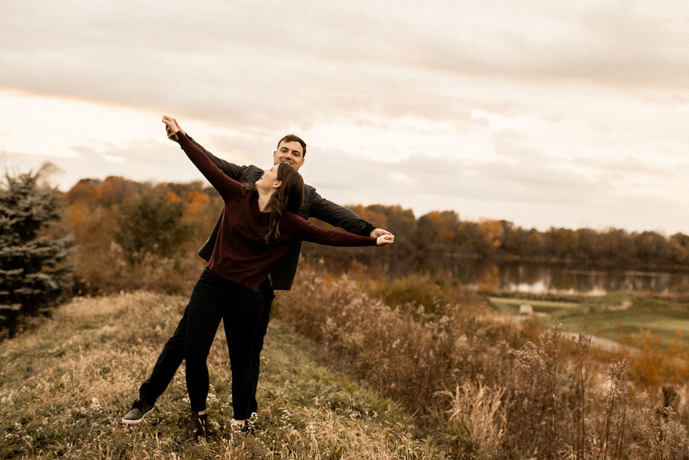 Indiana couple laughing during fall engagement session