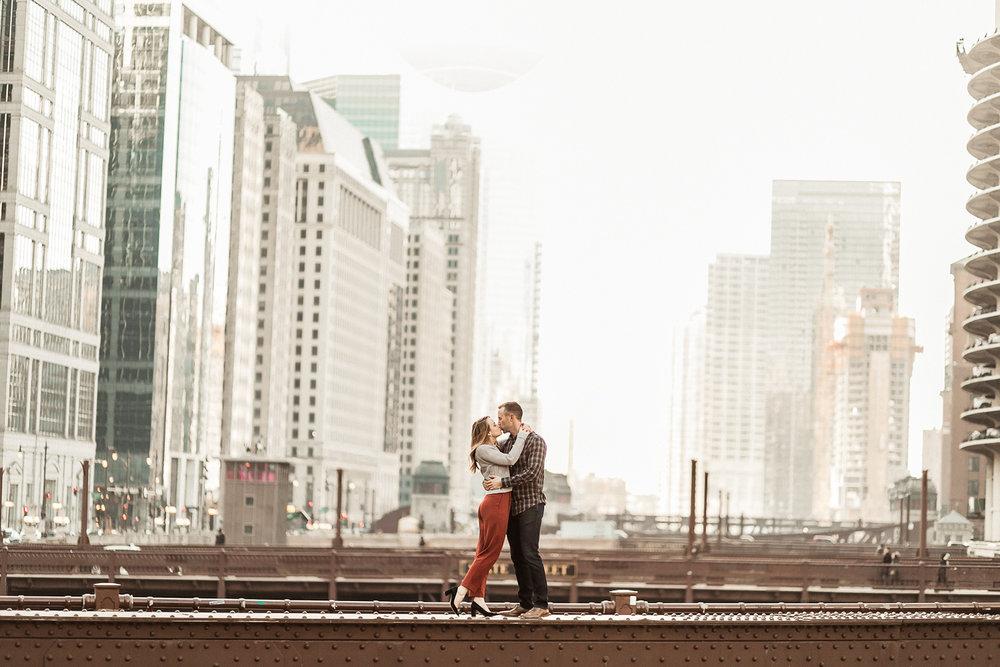 Chicago couple kissing on State Street Bridge