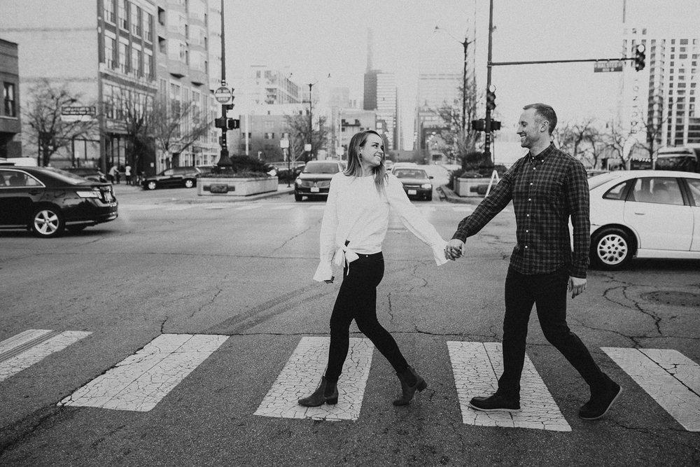 Couple crossing street in West Loop Chicago neighborhood